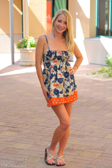 Petite blonde Casy shows you what's under her skirt on the patio