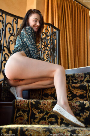 Fair skinned barefoot petite cutie Cecilia bending over and playing with her favorite toy