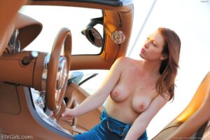 Sexy elegant FTV Girl Meghan teasing with her tits out by an exotic car