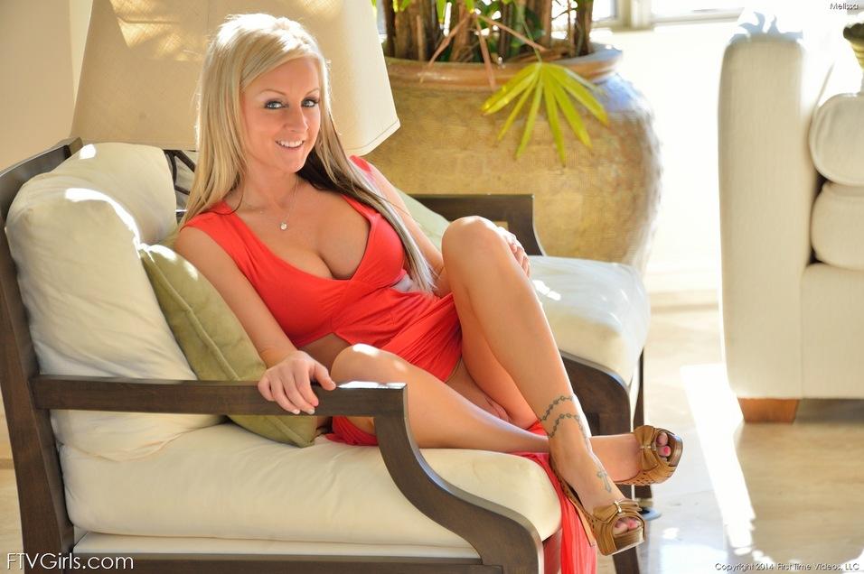 Blonde hottie Melissa fingers her shaved pussy under her skirt