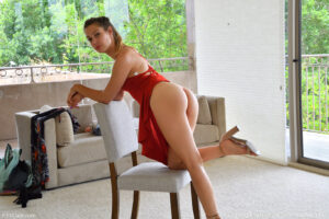 Slim blonde beauty Avery teases showing her pussy under her red dress