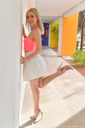 Sweet blonde teen Jamie in a skirt showing off her shaved pussy before squatting on her dildo