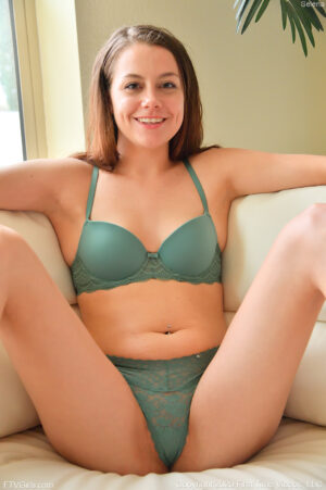 Cute FTV girl Serena wearing a bra fills her engorged labia with a huge cucumber