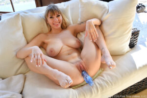 Big boobed blonde hottie Angel tests her swollen pussy with veggies and dildos