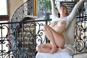Leggy busty blonde hottie Angel plays with her meaty pussy lips and her feet