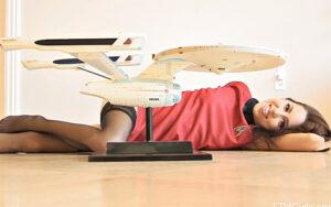 Brunette cutie Lola masturbates wearing stockings and a Star Trek uniform
