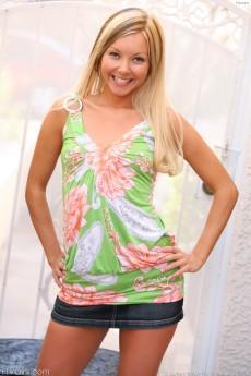 Blonde teen lass Tamara takes of her skirt in the dressing room