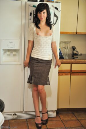Tasha plays in the kitchen