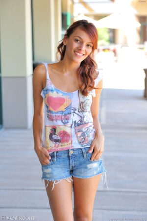 Redhead university student Valerie gets naked in public